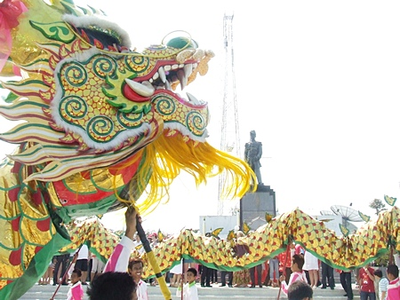 Dragon dancers perform at the Prince Chumporn Khet Udomsak Monument on Pratamnak Hill.