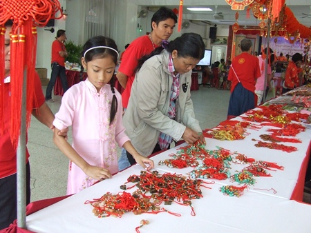 People of Thai-Chinese heritage purchase items for good luck.