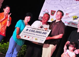 Boonchu (Khao By Si School), Phil Larkin (Regent's) and Mario (Centara) holding the cheque.