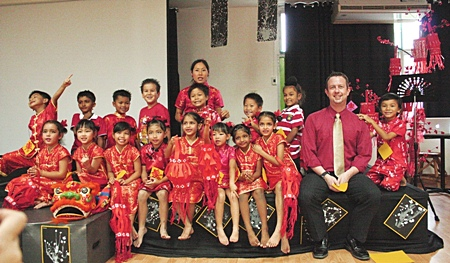The Year 1 students are dressed in their silky red finest traditional Chinese costumes in their class assembly.