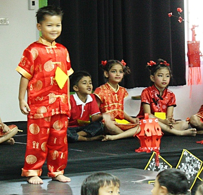 Ricky in yr 1 takes his turn to tell a story of Chinese New Year.