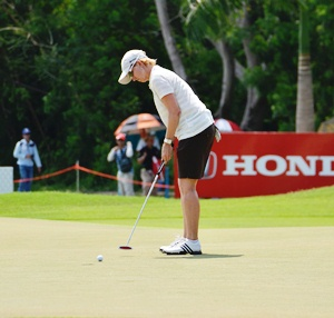 Carrie Webb putts for birdie on the short par-three 8th.