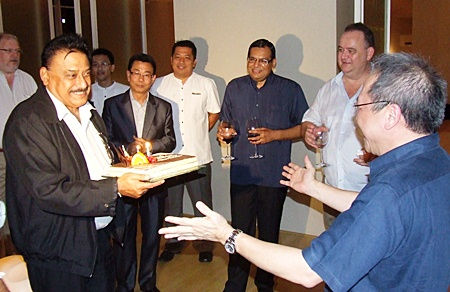 Peter seems moved as Chatchawal Supachayanont, GM Dusit Thani Pattaya and friends wish him a happy birthday.