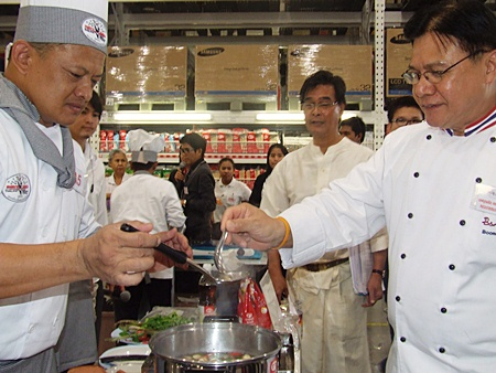 Chef Booncherd Sornsuwan (right) takes an early taste test of one of the contestant's creations.
