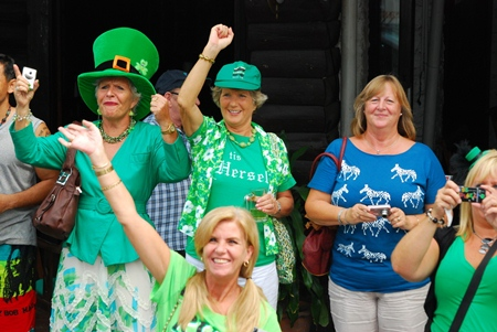 Excited participants in the St Patty's Day festivities cheer on the passing parade.