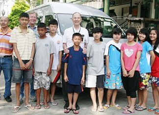 Suppachai Satheerasilapin (left), director of the Children's Home, Thomas J. Vincent (third left) and Brother Denis Gervais with the students who will use the new min-van each day.