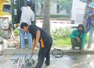 Workers repair the city's CCTV cameras along Beach Road ahead of last week's music festival.