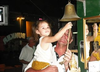 The Bunker Bar February 'golfer of the month' Peter Habgood gets some help ringing the bell from Lily.