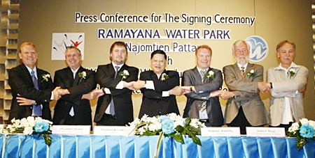 Chumpol Silapa-archa, the Minister Of Tourism & Sports, center, along with Ramayana Water Park and WhiteWater West Industries representatives shake hands at a press conference held April 8 at the Inter Continental Hotel in Bangkok to announce development plans for the water-park project.