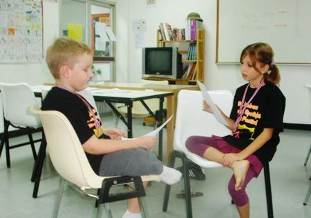 """Matt Walker and Galatee Cabanne practice their """"reader's theater"""" script."""