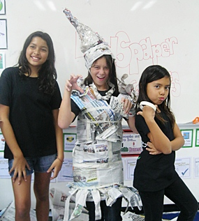 "Students make ""newspaper costumes"" and act out!"