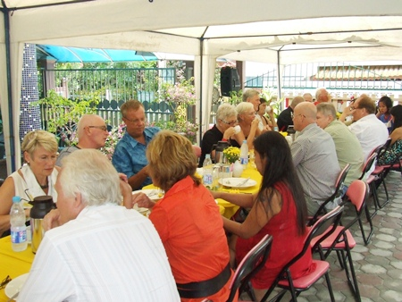 40-50 people enjoy meeting with their friends before church services during a free Norwegian breakfast.