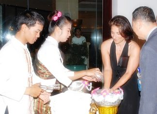 Guests are welcomed to the Royal Cliff's Songkran Dinner by the traditional ritual of Rod Nam Dam Hua.