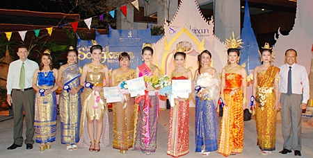 The 2011 Royal Cliff Miss Songkran Pageant finalists pose with General Manager Joachim Grill (far left) and Deputy General Manager Ranjith Chandrasiri (far right).