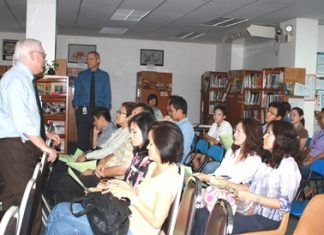 Dr. Brewitt helps Thai families prepare for university.