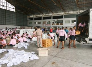 Seamen package and load supplies to send to flood victims in the south.