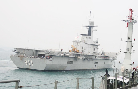 The HTMS Chakri Naruebet pulls into port in Sattahip.