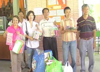 Members of the Pattaya Meditation Club arrive at the Banglamung Home for the Elderly bearing gifts.
