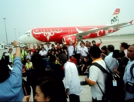 Carabao pose for the press in front of the specially painted plane