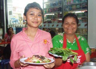 "It's ready to serve: Sompong Prachariko and her daughter Sukalyani Prachariko prepare to serve mom's signature dish, ""Larb Ped Buriram,"" or Buriram Spicy Minced Duck Salad."