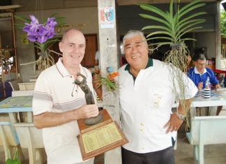 Winner Richard Hall, left, with the monthly trophy, is flanked by runner up Herb Ishinaga.
