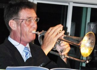 Award winning brass player, Clarence Mansell, performed several tunes.