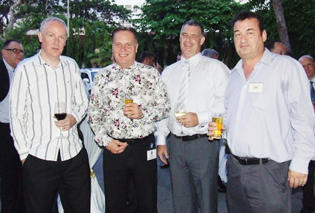 As dusk falls, Paul Melling, Standard Chartered Bank (Thai), Simon Matthews, Manpower/director BCCT, Joe Cox, Defence International Security Services and Joe Barker-Bennett, managing director of JMBB Consulting Co. Ltd., operator of Crestcom International Inc., enjoy pre dinner cocktails.
