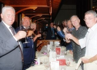 Members toast to the club's 10th anniversary.