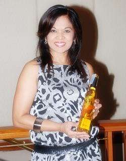 Chitra Chandrasiri displays the Flying Finix bottle she designed.