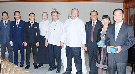(L to R) Choopong Payotorn, F&B manager at the Royal Cliff Grand Hotel; Veerasak Phongsai, head waiter; Vichai Poo-alai, restaurant manager of the Royal Grill Room & Wine Cellar; Stefan Beutler, asst. executive chef; Horst Rautert, pastry chef; Walter Thenisch, executive chef; Ranjith Chandrasiri, president of deVine Wine Club & deputy general manager of the Royal Cliff Hotels Group; Patt Srinoi, managing director & Anirut Posakrisna, chairman of Wine Dee Dee Group have put on a great night for all.