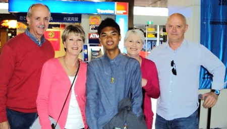 Micky was met by his new family on arriving in Australia.