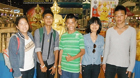 Micky, second left, with friends at the airport in Bangkok.