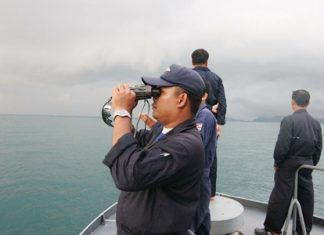 A Navy search and rescue team scours the horizon for signs of the missing Russian tourist.