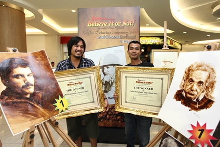 Jintanakarn Maneerat (left) won top prize for his painting of Freddie Mercury, whilst Ruangyot Kungsasri (right) won the student category for his drawing of Albert Einstein.