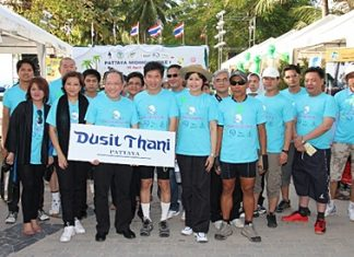 Dusit general manager, Chatchawal Supachayanont, third left, stands with Dr. Jirapol Sinthunava of the Green Leaf Foundation, fourth left, and other riders at the Pattaya Midnight Bike ride on Saturday, April 30.