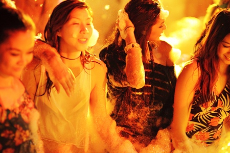 The girls talk time out from the competition to relax at the Hardrock's foam party.