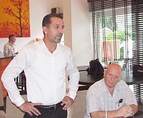Miki Haim, Managing Director of Matrix, left, addresses the members of REBA during their monthly meeting.
