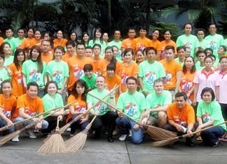 To commemorate World Environment Day June 5, Pierre Andre Pelletier (centre), general manager of the Amari Watergate, handed a broom to each of his management team and staff and led them in sweeping the sidewalk at the Rajthevi Intersection and along the Petchaburi Road.