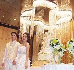 Models Palm and Yui wearing wedding attire pose in the Seaboard Ballroom of Hilton Pattaya.