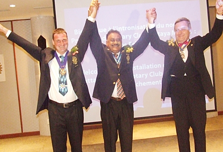 PDG Peter hails outgoing President Eric Larbouillat (left) and incoming President Yves Echement, Rotary Club Pattaya Marina.