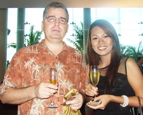 Mihai Cuza and the lovely Penpapasorn Eamsa-ard Senior Sales Manager Sheraton Pattaya Resort enjoy a glass of sparkles at sunset.