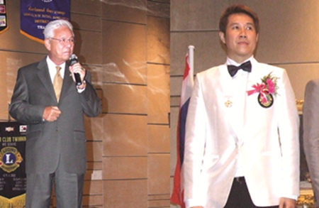 (Left) Kajit Habanananda, Lions Clubs International Past President, (Right) Banchong Bunthoonprayuk District Governor 310C (2011-12).