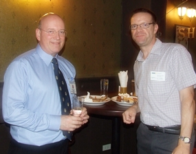 Graham Macdonald (chairman of the BCCT) and Roger Wilson (GKN Driveline) find a quiet corner to nibble on the delicious ribs.