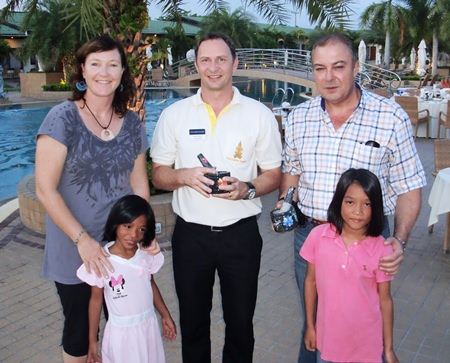 (From left) Orphanage Director Karen Sanchez with Thai Garden Resort Manager Danilo Becker and General Manager Rene Pisters.