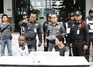 Police bring out allegedly drug dealers Mbaeri Ejike Chinyere (left) and Nantana Watcharapongsakul (right) for the press to photograph.