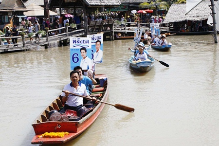 Palang Chon candidates take to boats to hand out leaflets promoting their political platform.