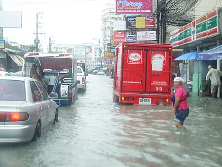 Another rain storm, another bout of uncontrolled flooding - torrential rain June 13 paralyzed downtown Pattaya, with knee-deep water drowning many of the sois between Beach and Second roads.