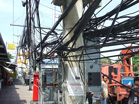 The city has restarted an attempt to clean up the unsightly mess of unused wires around town, embarrassing local utility company management who were told to do this themselves a long time ago.