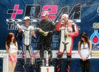 Ben Fortt, 2nd left, celebrates on the podium following his second place finish at Nakhon Chaise, Sunday, June 19.