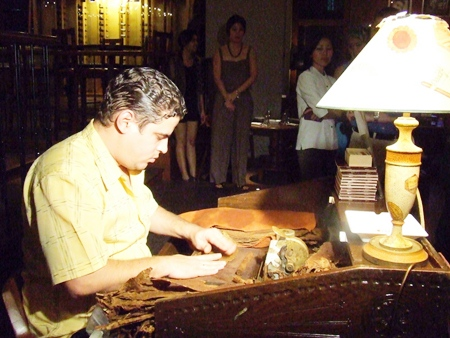 Hocnial Diaz Valdez demonstrates the fine art of cigar making.